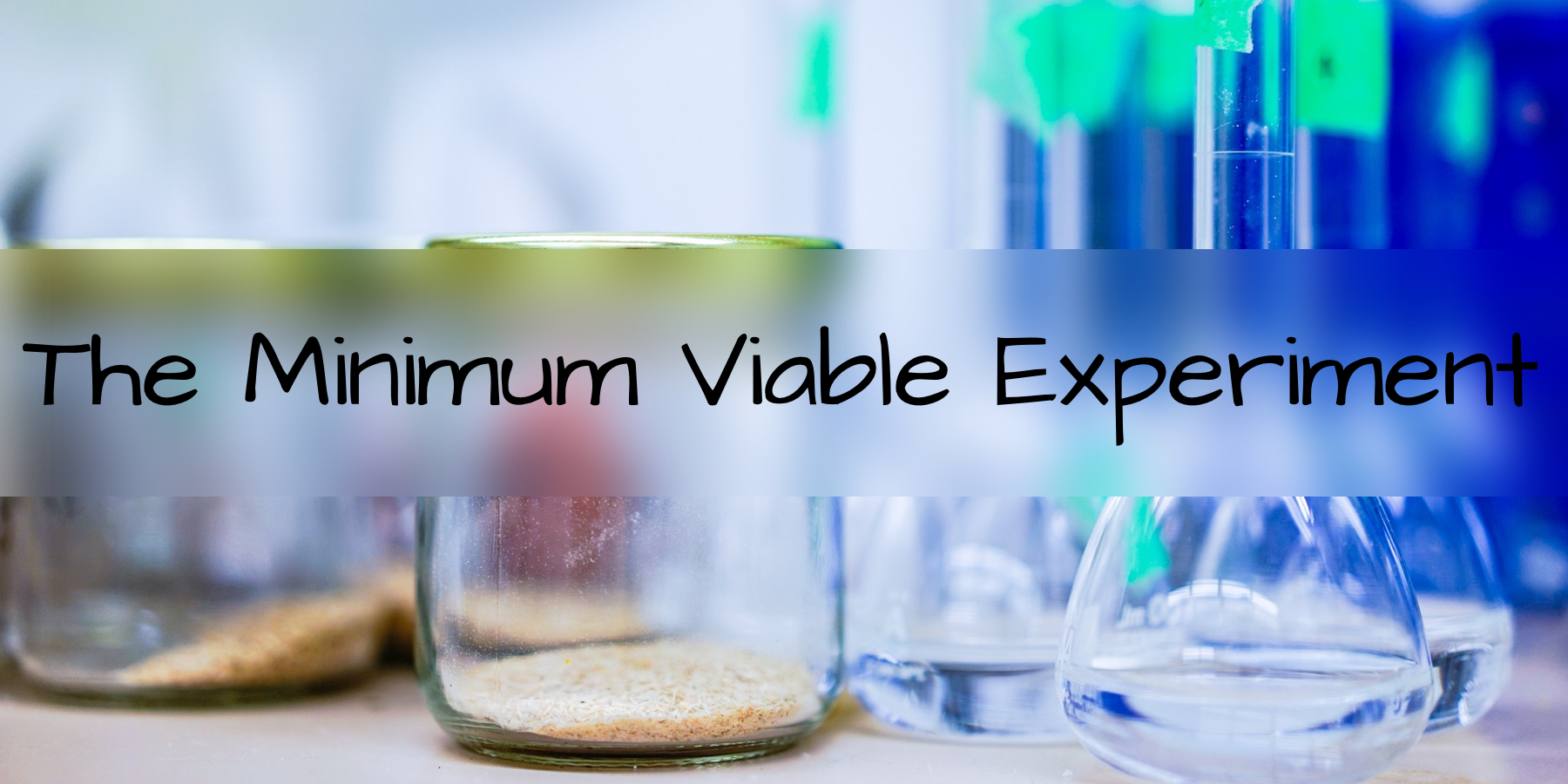 "picture of beakers and experimental jars with the words ""the minimum viable experiment"" written over top"